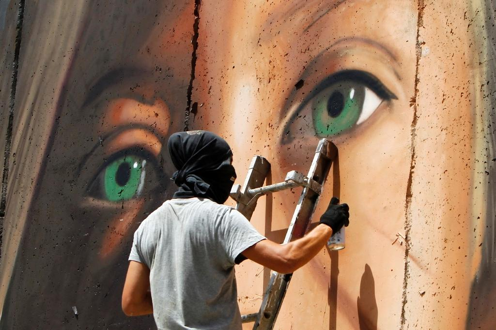 It Takes Village To Paint Mural Sharon >> Israel Releases Italians Who Painted Mural Of Palestinian Teen