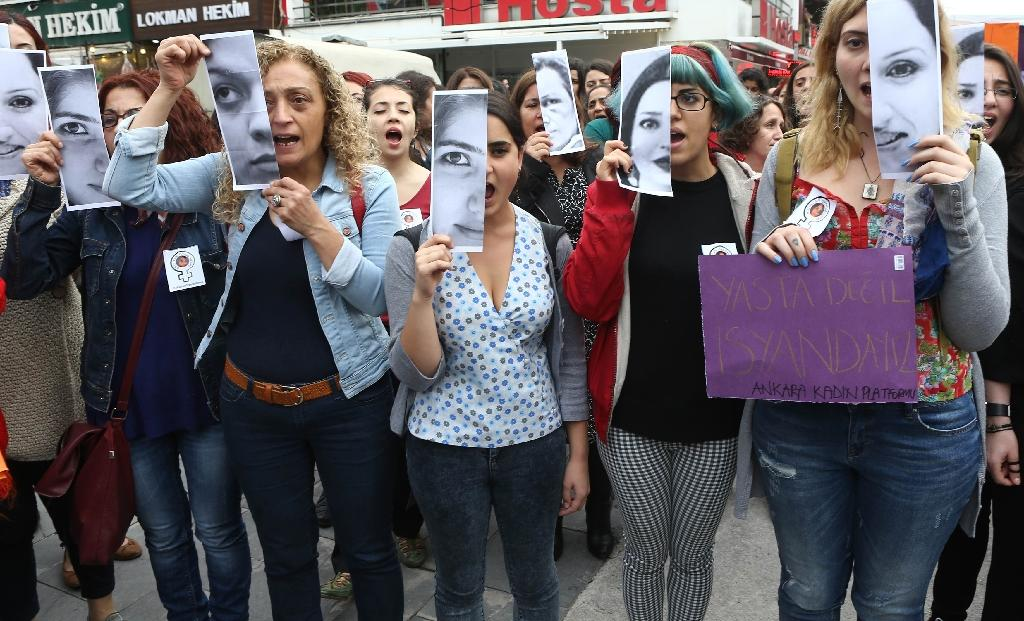 Turkish women display photographs of slain student, Ozgecan Aslan, who was killed while resiting an attempted rape, during a demonstration in Ankara on June 12, 2015