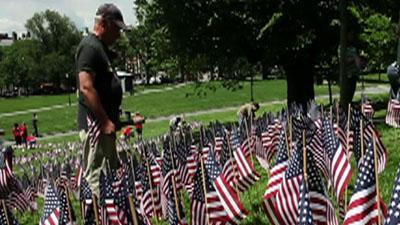 Father plants flags to remember son, soldiers