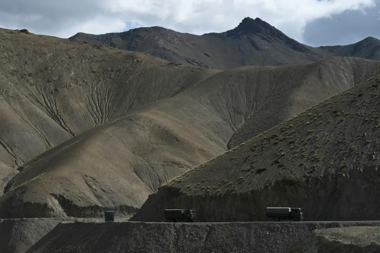 An Indian military convoy drives towards Leh in the Ladakh region