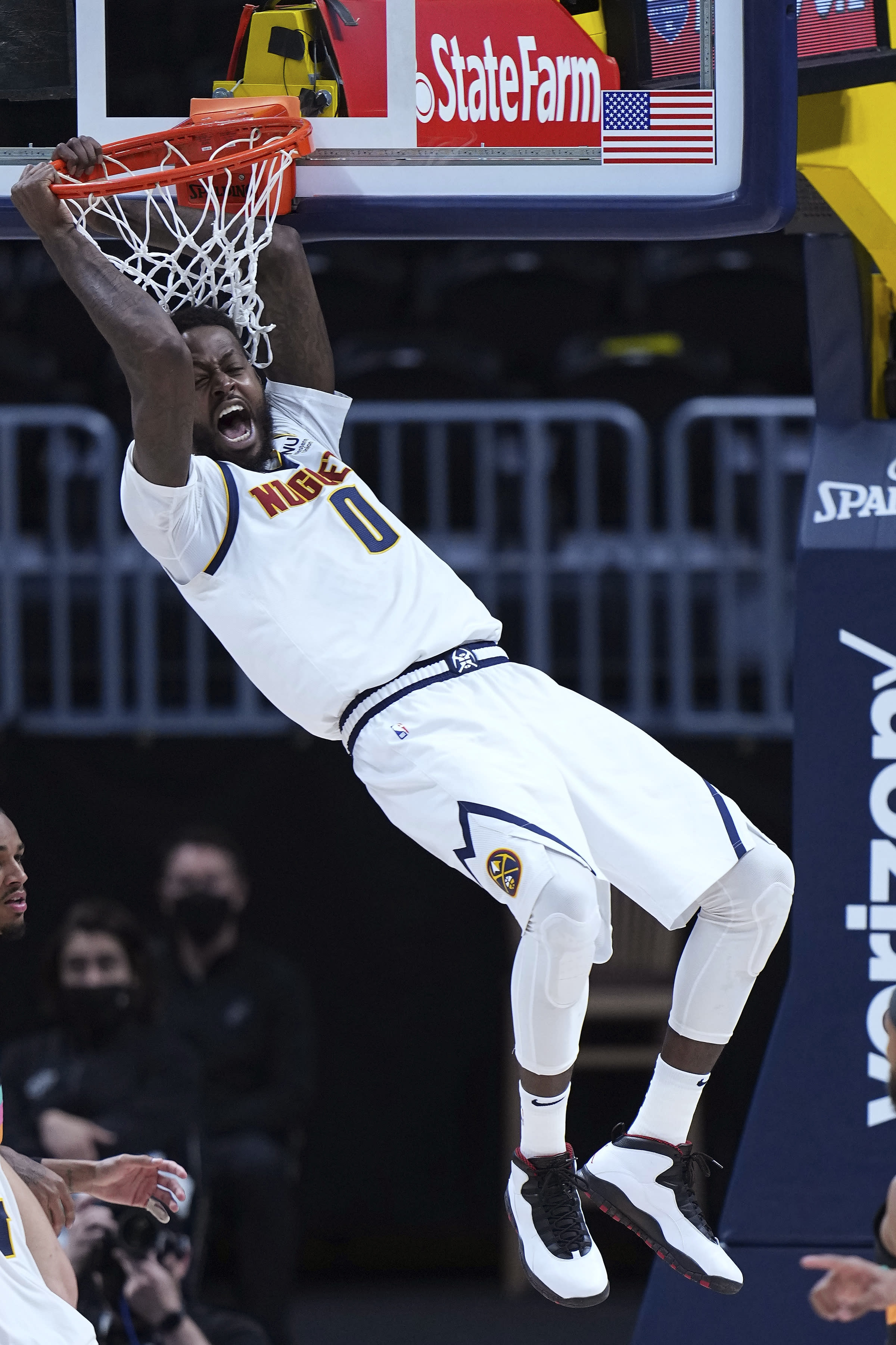 Denver Nuggets forward JaMychal Green reacts after a dunk against the San Antonio Spurs during the first quarter of an NBA basketball game Wednesday, April 7, 2021, in Denver. (AP Photo/Jack Dempsey)