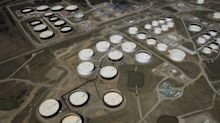 Oil steadies as US crude inventories drop