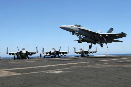F/A-18 fighter jet takes off at the USS Harry S. Truman aircraft carrier in the eastern Mediterranean Sea. REUTERS/Andrea Shalal
