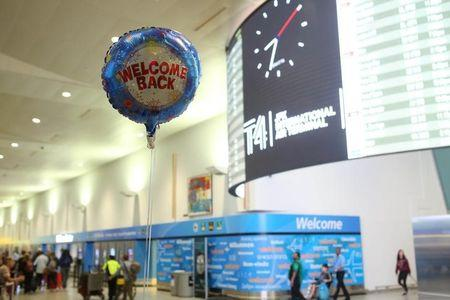 """A balloon reading """"Welcome Back"""" is seen at the arrival hall at Terminal 4 of JFK airport after U.S. President Donald Trump's limited travel ban was approved by the U.S. Supreme Court, in New York City, U.S., June 29, 2017. REUTERS/Joe Penney"""