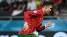 Ronaldo equals international scoring record as Portugal edge into last 16