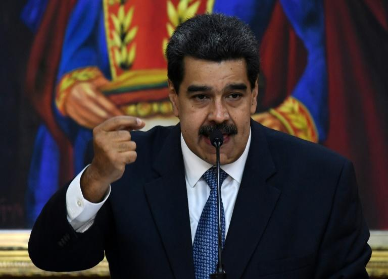 "Venezuelan President Nicolas Maduro has been blamed for the death under ""torture"" of a detained naval officer (AFP Photo/Yuri CORTEZ)"
