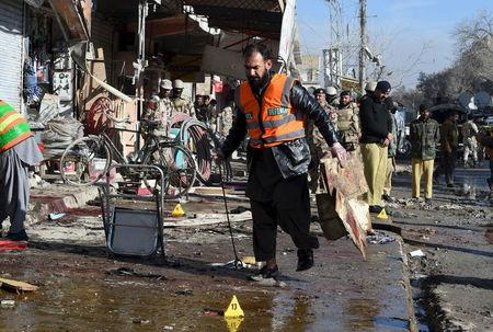 A rescue worker collects evidence from the site of a suicide bomb attack close to a polio eradication centre in Quetta, Pakistan, January 13, 2016. REUTERS/Stringer
