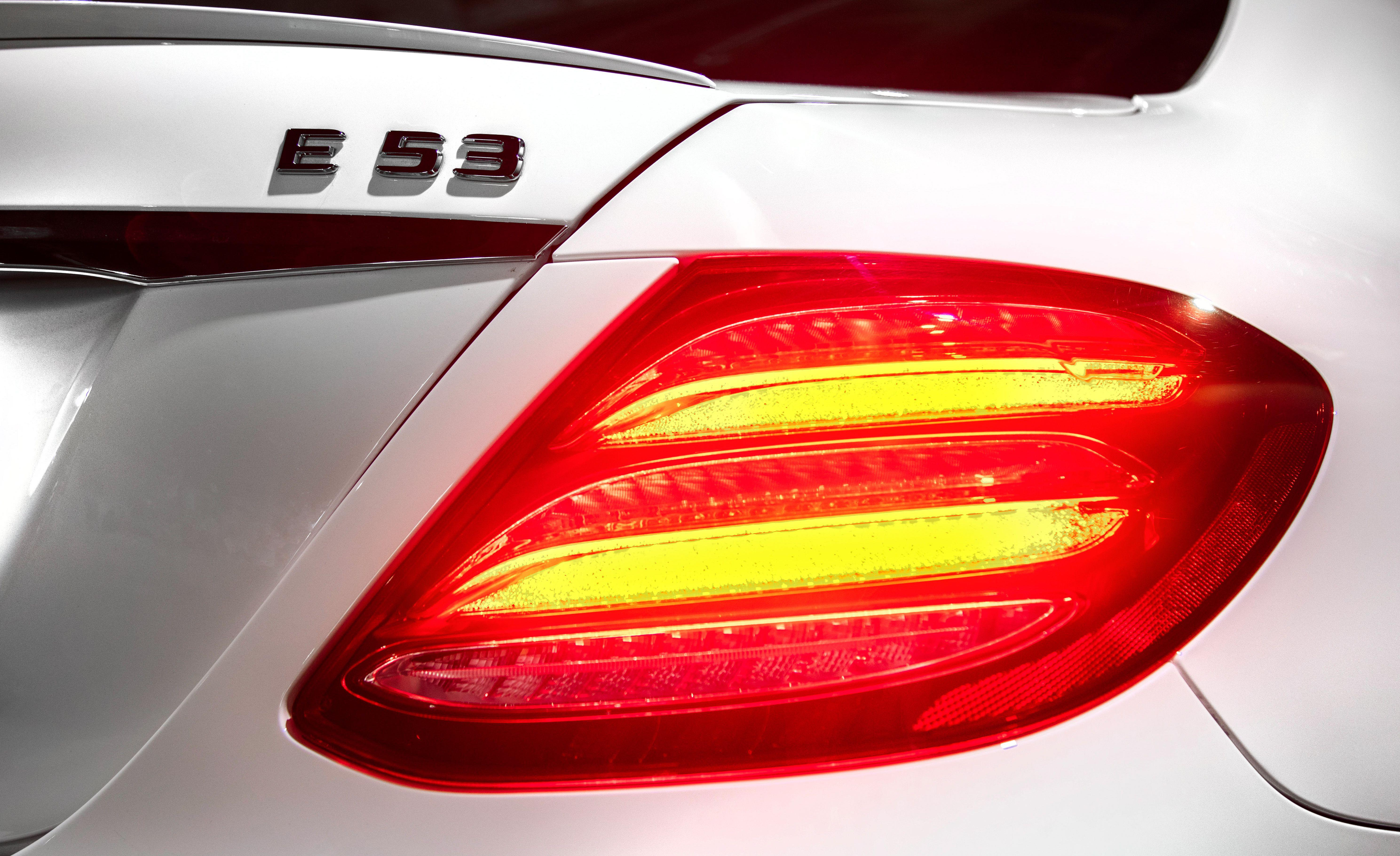 """<p>Although <a href=""""https://www.caranddriver.com/mercedes-amg/e53"""" rel=""""nofollow noopener"""" target=""""_blank"""" data-ylk=""""slk:the 2019 Mercedes-AMG E53"""" class=""""link rapid-noclick-resp"""">the 2019 Mercedes-AMG E53</a> sedan isn't shy about announcing its AMG pedigree, it leads a more nuanced existence. With <a href=""""https://www.caranddriver.com/mercedes-amg/gt53"""" rel=""""nofollow noopener"""" target=""""_blank"""" data-ylk=""""slk:AMG's GT53 four-door"""" class=""""link rapid-noclick-resp"""">AMG's GT53 four-door</a> and the single-minded AMG GT63 with its 577-hp twin-turbo V-8 on offer to indulge four-door buyers seeking performance above all else, the E53 sedan, like it's <a href=""""https://www.caranddriver.com/reviews/a24480262/2019-mercedes-amg-e53-4matic-coupe-by-the-numbers/"""" rel=""""nofollow noopener"""" target=""""_blank"""" data-ylk=""""slk:E53 coupe"""" class=""""link rapid-noclick-resp"""">E53 coupe</a> and E53 cabriolet siblings, is free to focus on easing some heightened excitement into the traditional E-class social structure.</p>"""