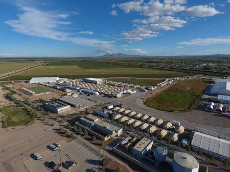 A tent city set up to hold immigrant children separated from their parents or who crossed the U.S. border on their own is seen in Tornillo, Texas, U.S., in this U.S. Department of Health and Human Services (HHS) image released on October 12, 2018. Courtesy HHS/Handout via REUTERS