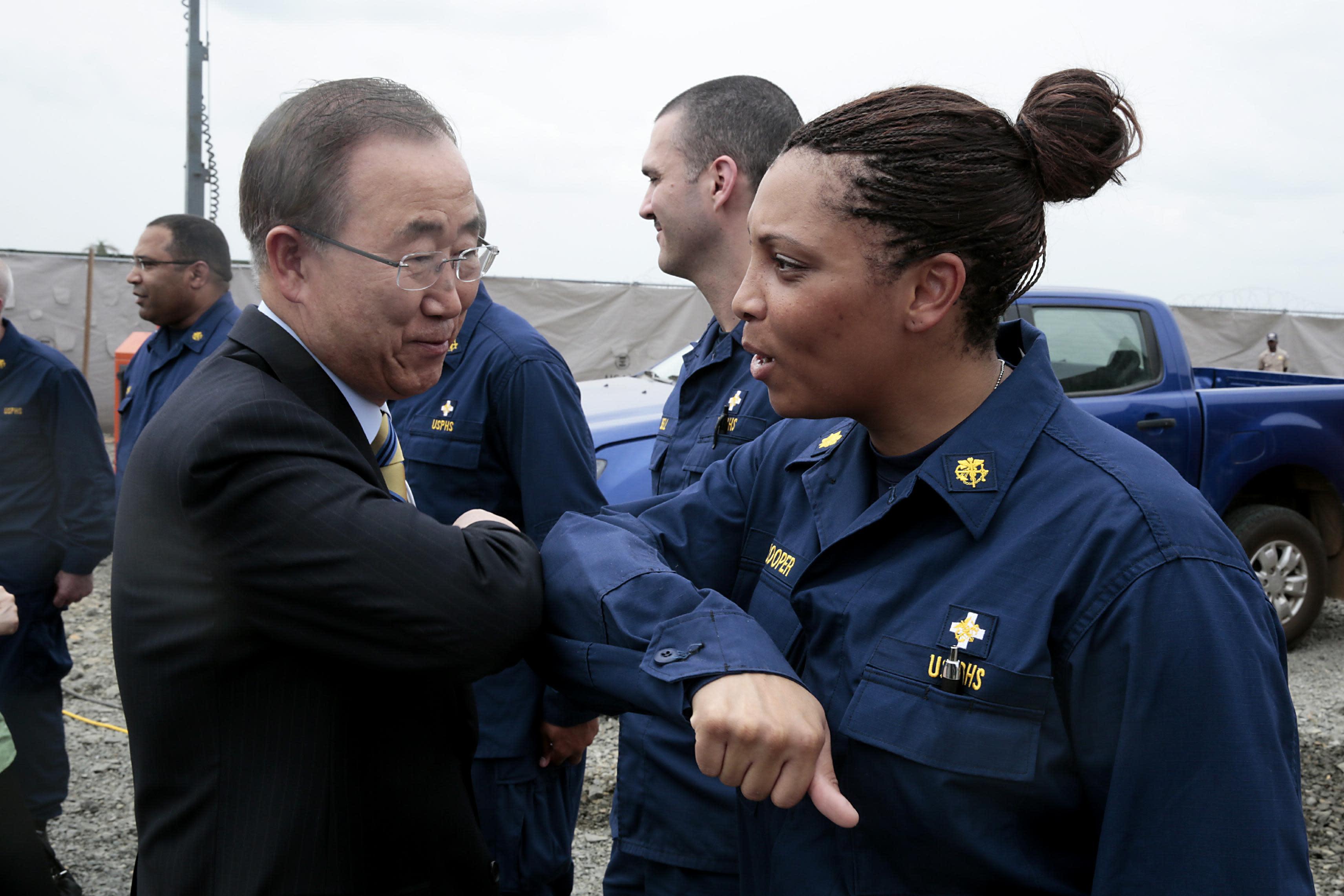 UN chief Ban Ki-moon greets a member of a medical unit on December 19, 2014 in Monrovia (AFP Photo/Evan Schneider)