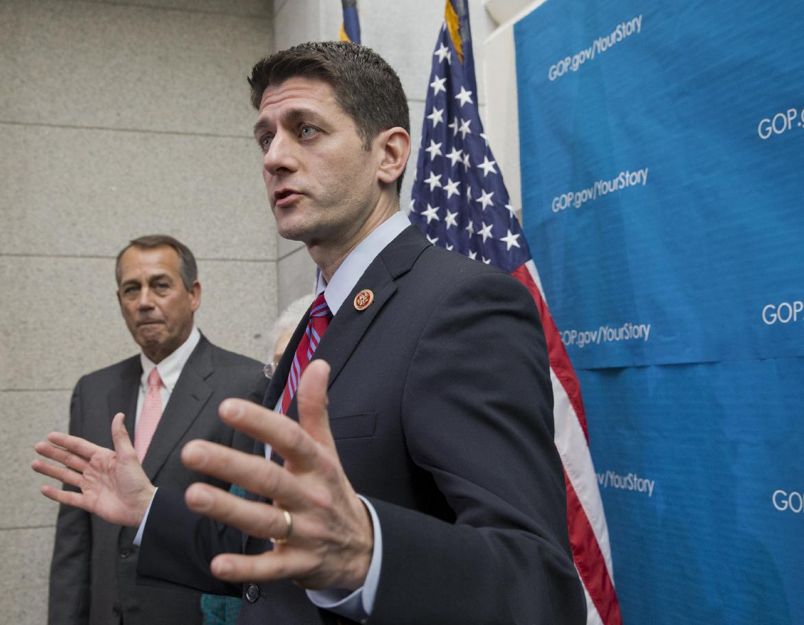 This photo taken Dec. 11, 2013 shows House Budget Committee Chairman Rep. Paul Ryan, R-Wis., right, accompanied by House Speaker John Boehner of Ohio speaking during a news conference on Capitol Hill in Washington. Republican leaders and several hard-right groups are in the throes of a bitter political divorce marked by name-calling and deep suspicions. The eagerness of House Speaker John Boehner and Senate Minority Leader Mitch McConnell to lash out at groups that have given them fits for the past few years has unshackled others in the Republican ranks, who bluntly question the motivation of organizations such as the Senate Conservatives Fund, Heritage Action, Madison Project and Club for Growth. (AP Photo/J. Scott Applewhite)