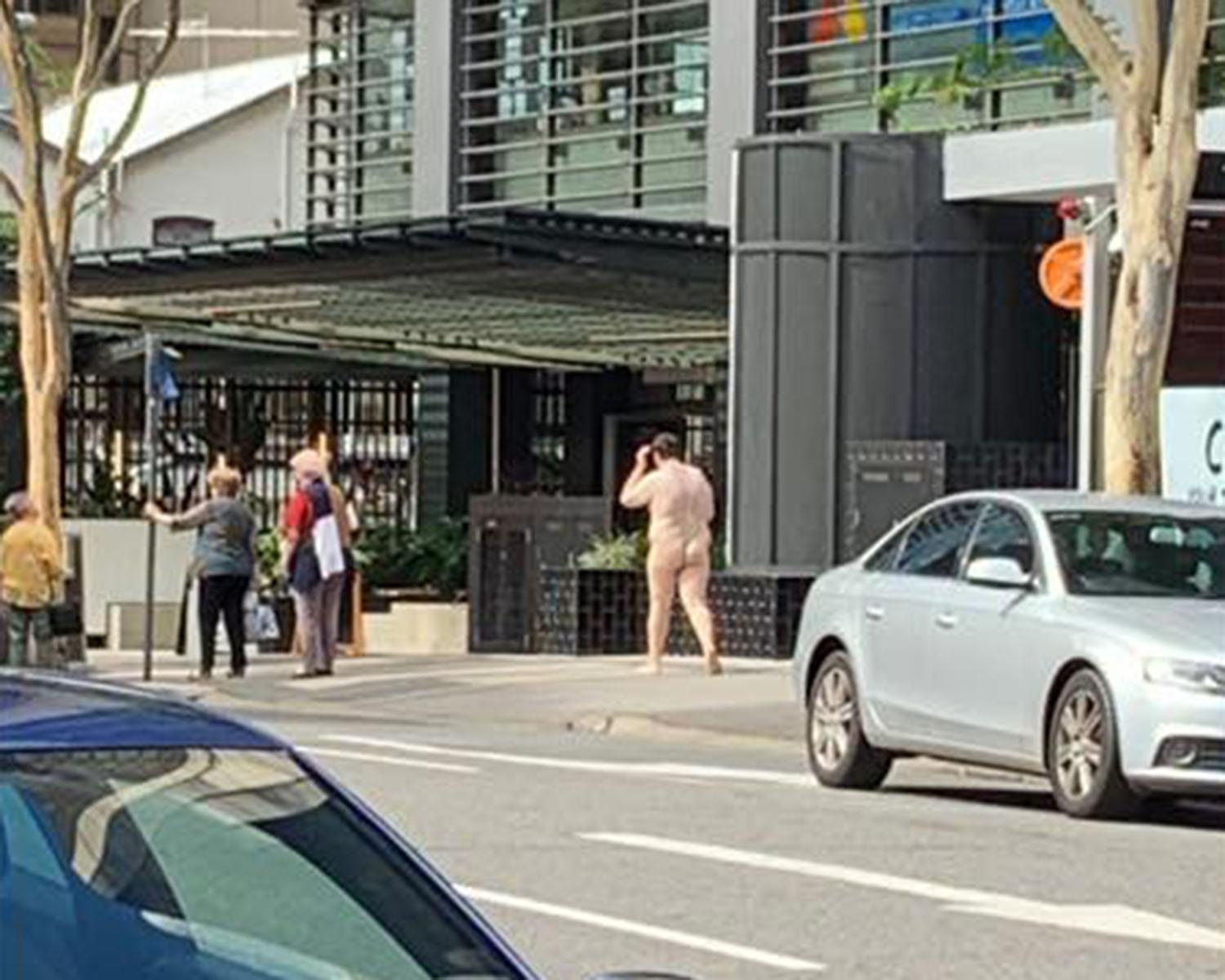 Man spotted strolling casually down the street - completely naked
