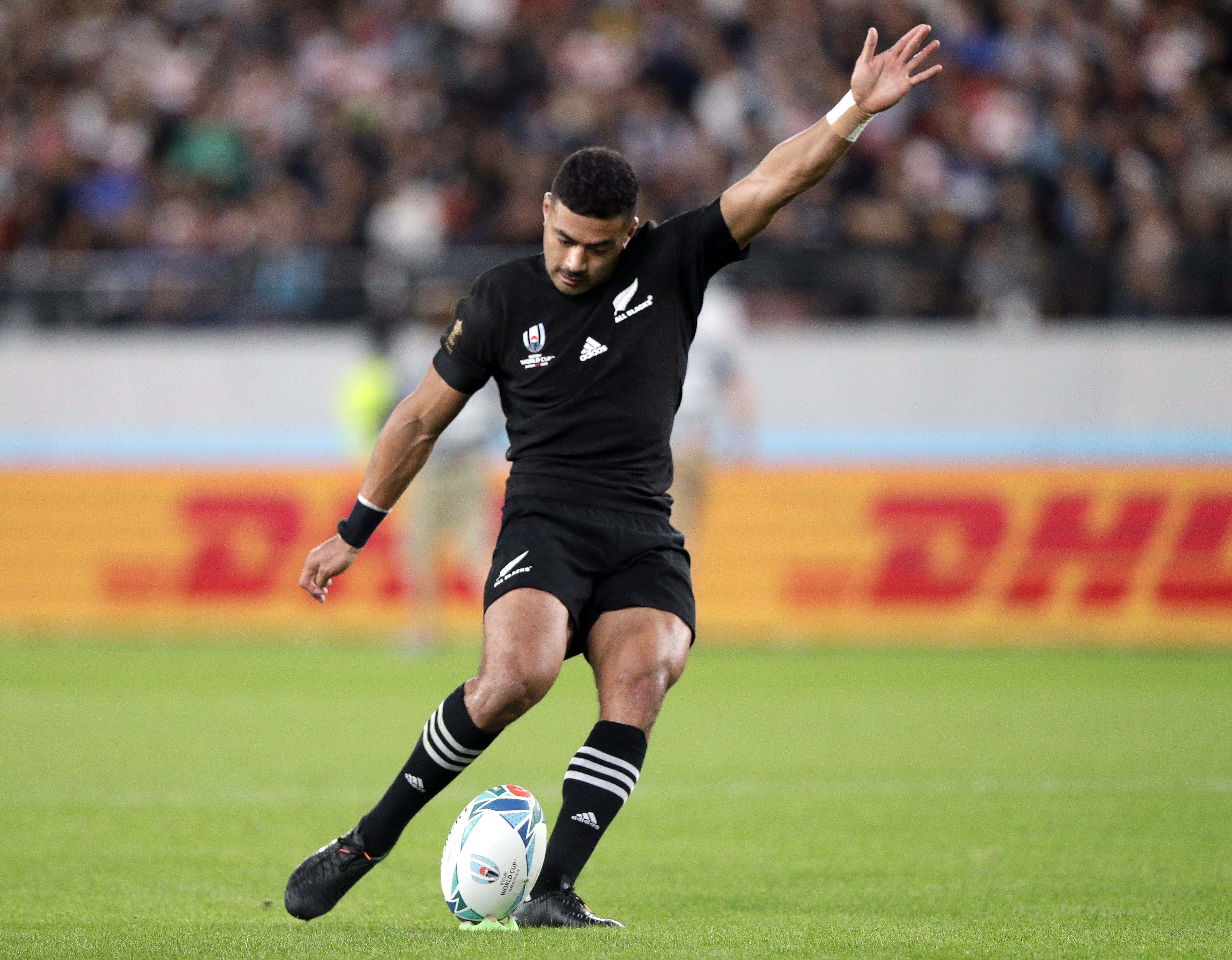 FILE - In this Nov. 1, 2019, file photo, New Zealand's Richie Mo'unga kicks a conversion during the Rugby World Cup bronze final game against Wales at Tokyo Stadium, in Tokyo. New All Blacks head coach Ian Foster opted for the in-form Mo'unga at No. 10 ahead of the incumbent Beauden Barrett, a two-time World Rugby Player of the Year who will start at fullback in the first Bledisloe Cup test against Australia, Sunday, Oct. 11, 2020. (AP Photo/Mark Baker, File)