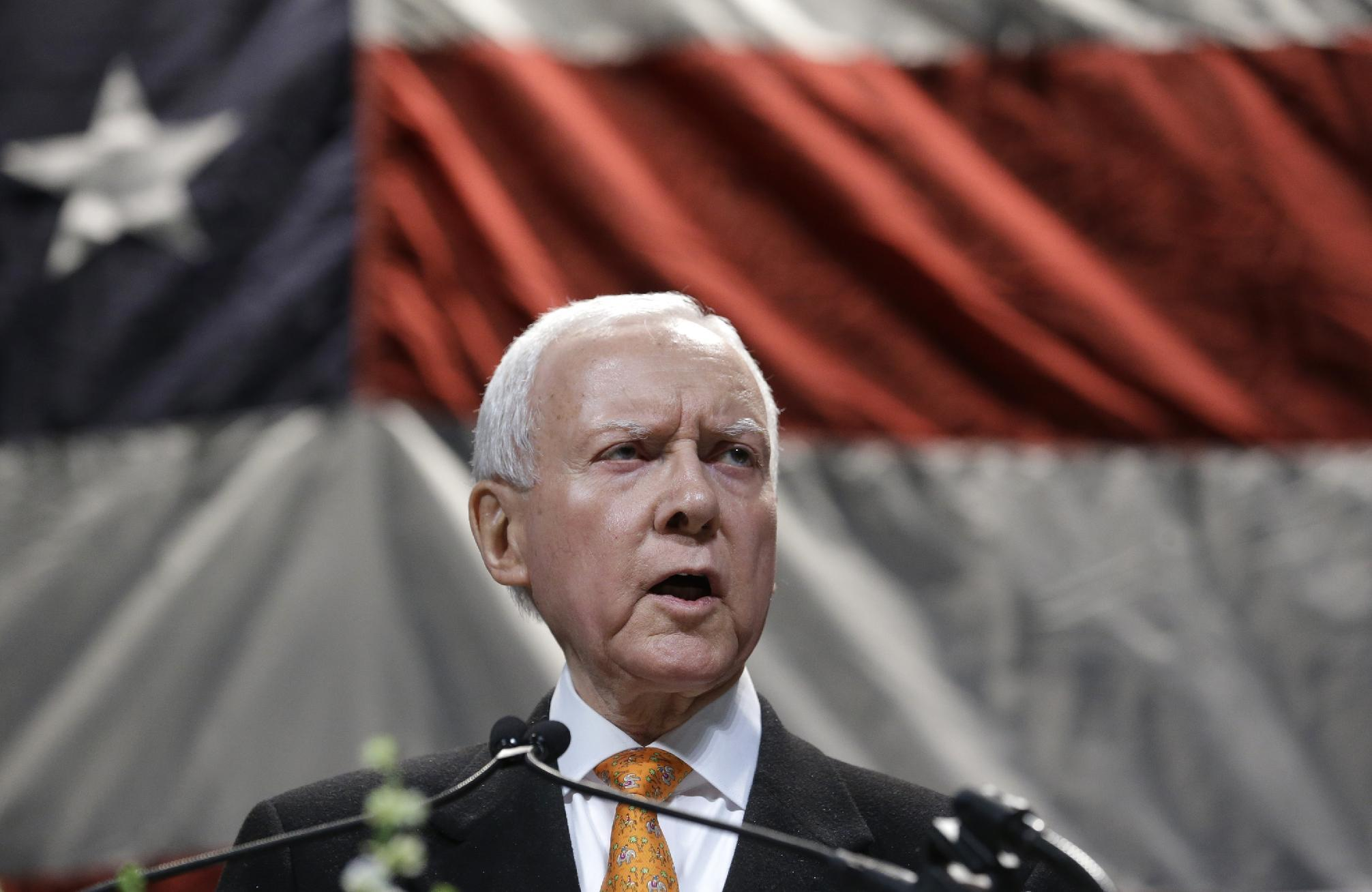 """U.S. Sen. Orrin Hatch addresses the Utah Republican Party's annual organizing convention Saturday, May 18, 2013, in Sandy, Utah. Hatch says staffers at the Internal Revenue Service, which recently apologized for unfairly targeting tea party groups, """"are either deliberately incompetent or they are evil."""" Hatch mentioned the IRS scandal while addressing thousands of fellow Republicans in Sandy on Saturday for the state party's annual organizing convention. Hatch says the IRS scandal is more concerning than almost anything else he's seen in the 36 years he's been in the U.S. Senate. (AP Photo/Rick Bowmer)"""