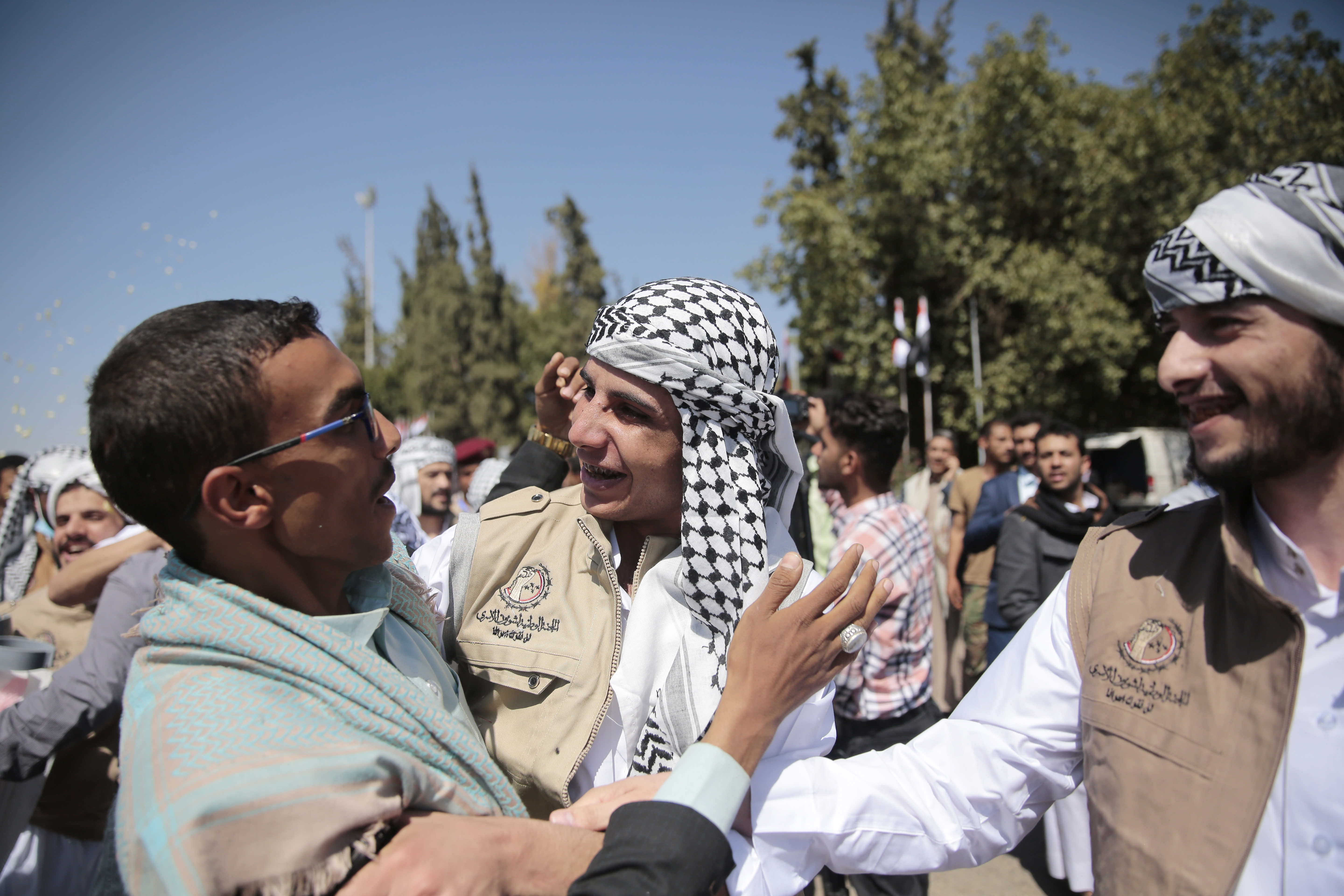 Yemeni prisoner are greeted by his relative after being released by the Saudi-led coalition, at the airport in Sanaa, Yemen, Thursday, Oct. 15, 2020. (AP Photo/Hani Mohammed)