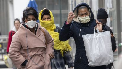 Americans turning to wearing masks amid virus