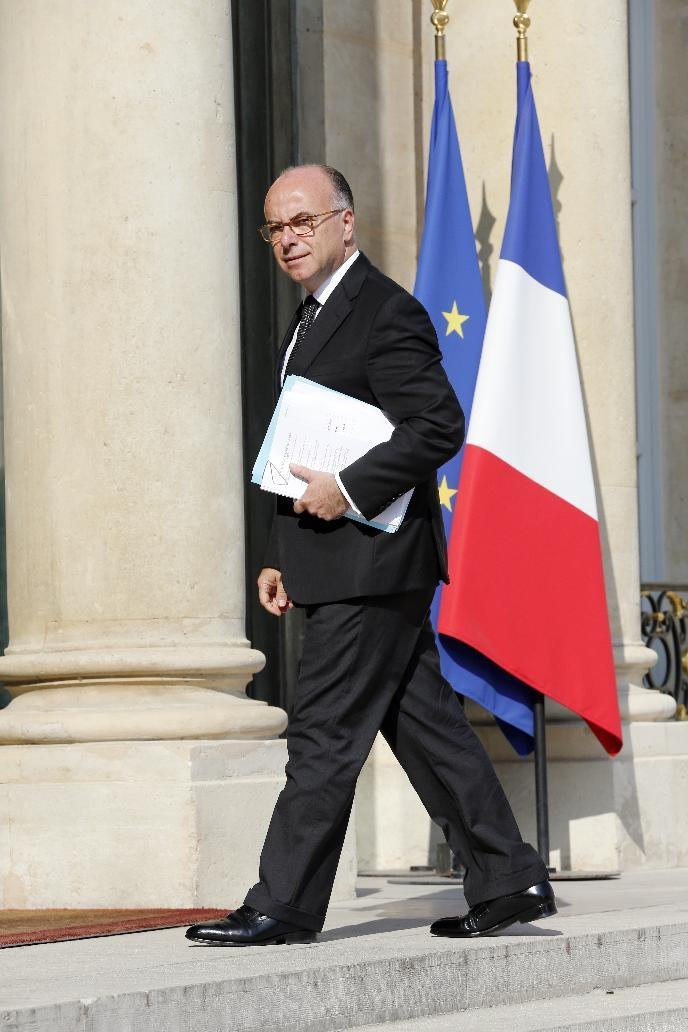 French Interior Minister Bernard Cazeneuve arrives on July 26, 2014 at the Elysee palace in Paris (AFP Photo/Francois Guillot)