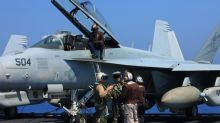 From a Navy carrier, pilots take aim at ISIS. On the ground in Iraq, civilians suffer.