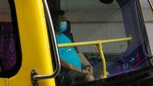Hong Kong tightens coronavirus restrictions as cases hit record
