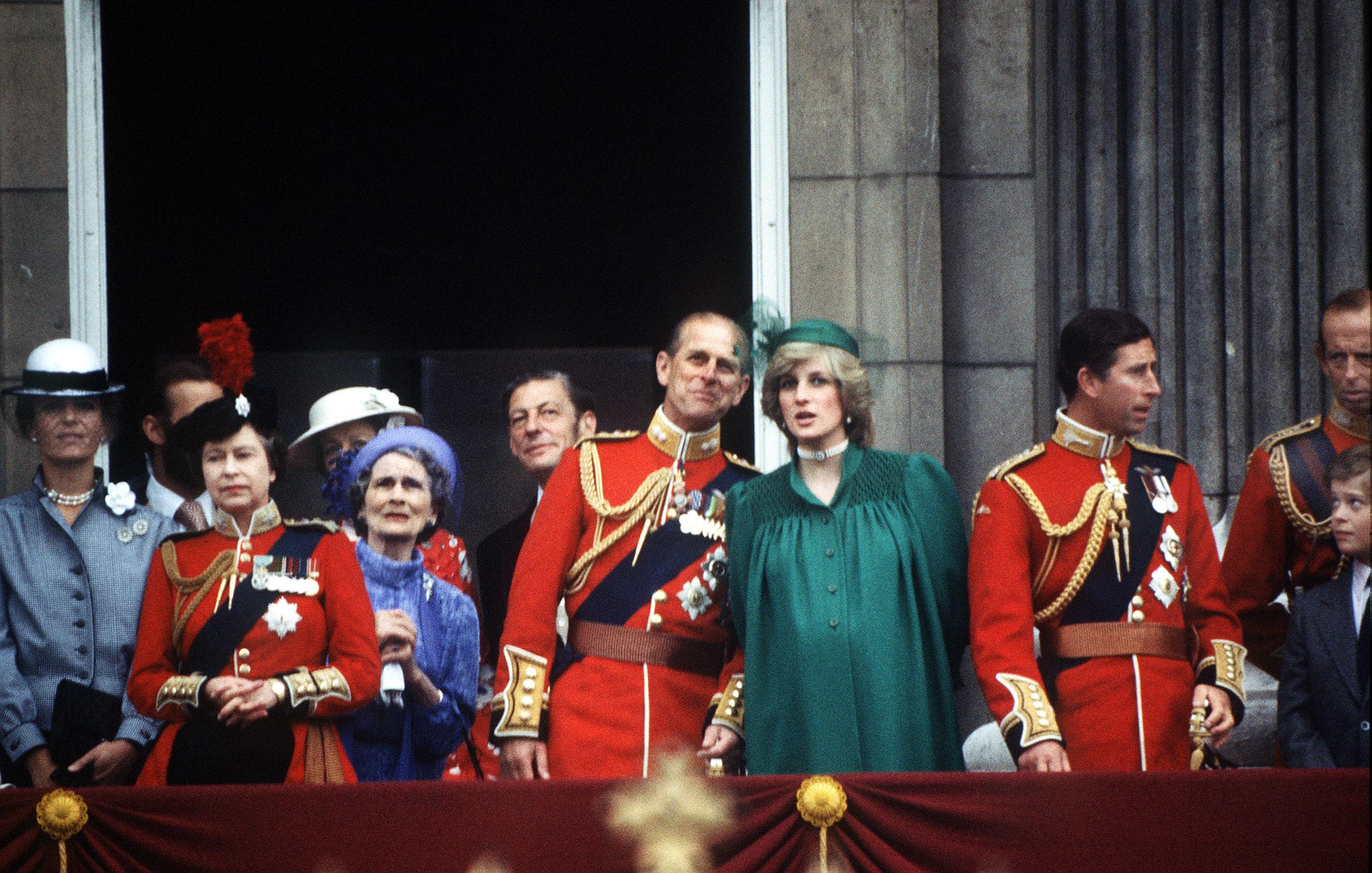 A pregnant Princess of Wales joins the royal family on the balcony of Buckingham Palace for the Trooping of the Colour ceremony, June 1982. The Queen, Prince Philip, Princess Alexandra of Kent and Angus Ogilvy are among the group.