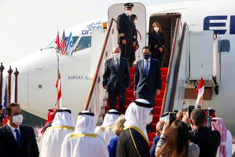 The head of Israel's National Security Council Meir Ben-Shabbat (L) and US Treasury Secretary Steve Mnuchin arrive in Bahrain