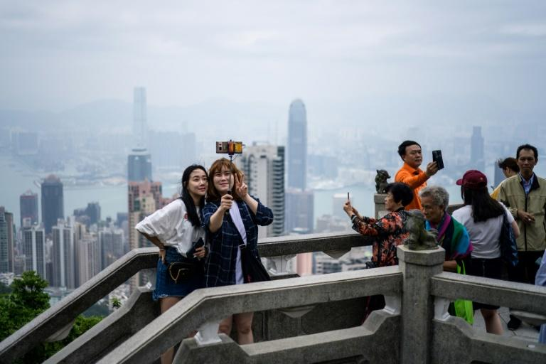 Hong Kong is a popular tourist destination (AFP Photo/ANTHONY WALLACE)