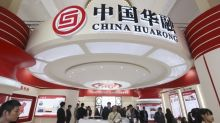 As chairman investigated over graft, China's Huarong told to control risks