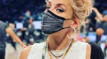 Busy Philipps causes a stir as she poses in crocheted top for basketball game