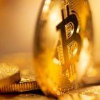 Bitcoin off record highs, slumps 7% in volatile trade