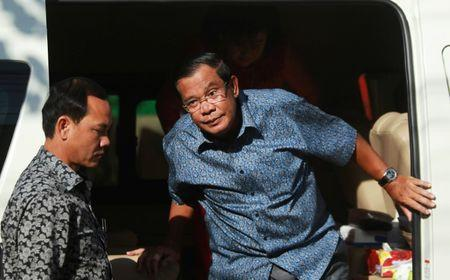 Cambodia's Prime Minister Hun Sen arrives to register for next year's local elections, in Kandal province