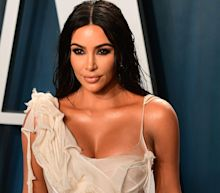 Kim Kardashian is being roasted on Twitter after saying she rented a private island to 'pretend things were normal'
