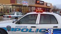 Suspects at large in cell phone store robbery, murder