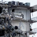 Florida condo building partially collapses, killing at least one person
