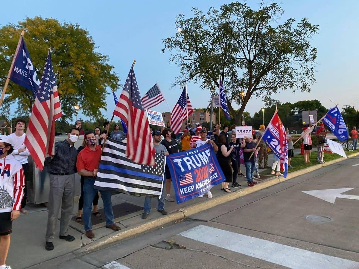 "The rally occurred near the ""Coronavirus Death Scoreboard"" at Triangle Park."