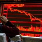 Global stocks sink to four-week low, dollar stands tall