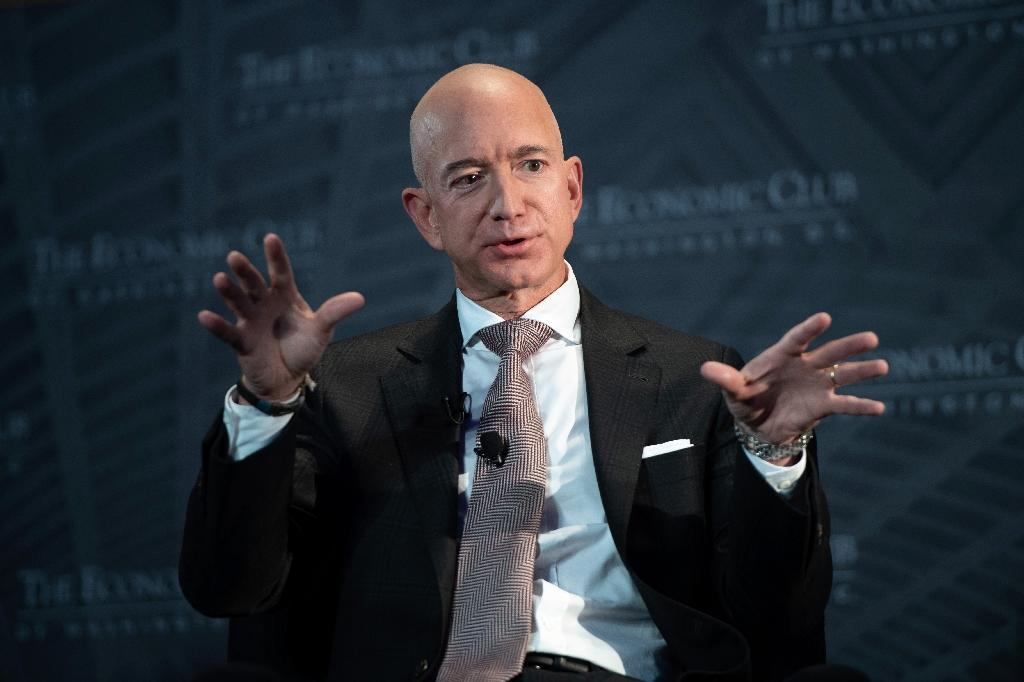 Jeff Bezos, founder and CEO of Amazon, told an Economic Club of Washington dinner he will add to his $2 billion philanthropic initiative (AFP Photo/SAUL LOEB)