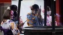 The Latest: Japan's virus surge fills isolation facilities