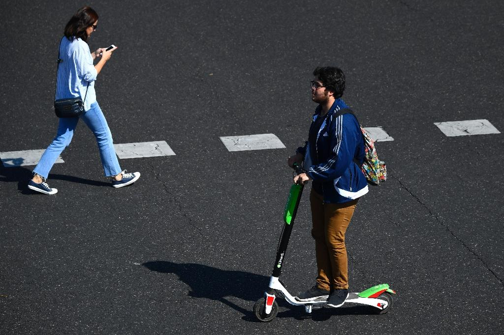 Electric scooter sharing schemes have popped up in city streets across Spain and elsewhere in Europe (AFP Photo/GABRIEL BOUYS )