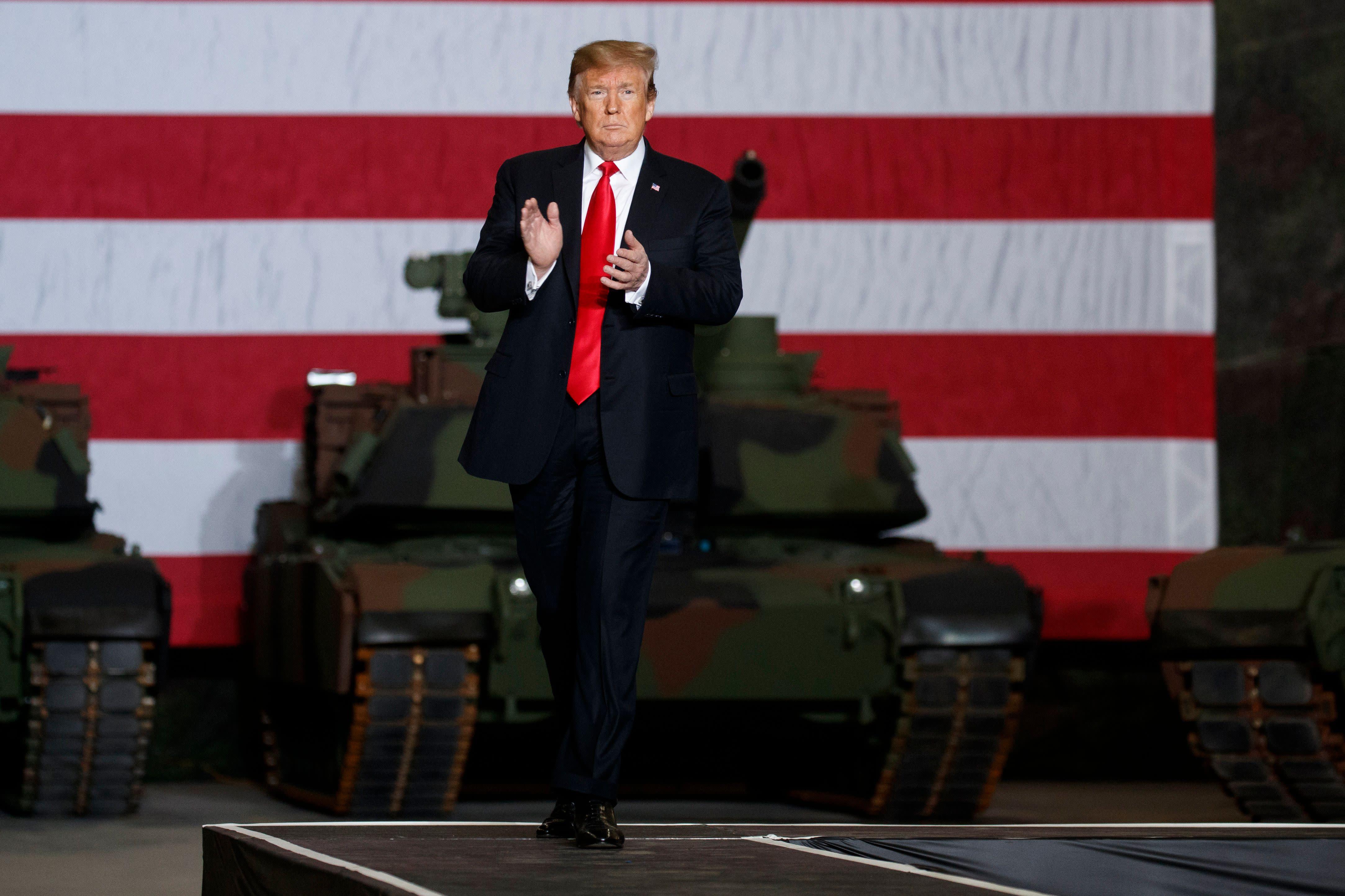 Trump visits tank factory and renews attack on war hero McCain