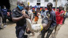 Stampede in Kenya as slum residents surge for food aid