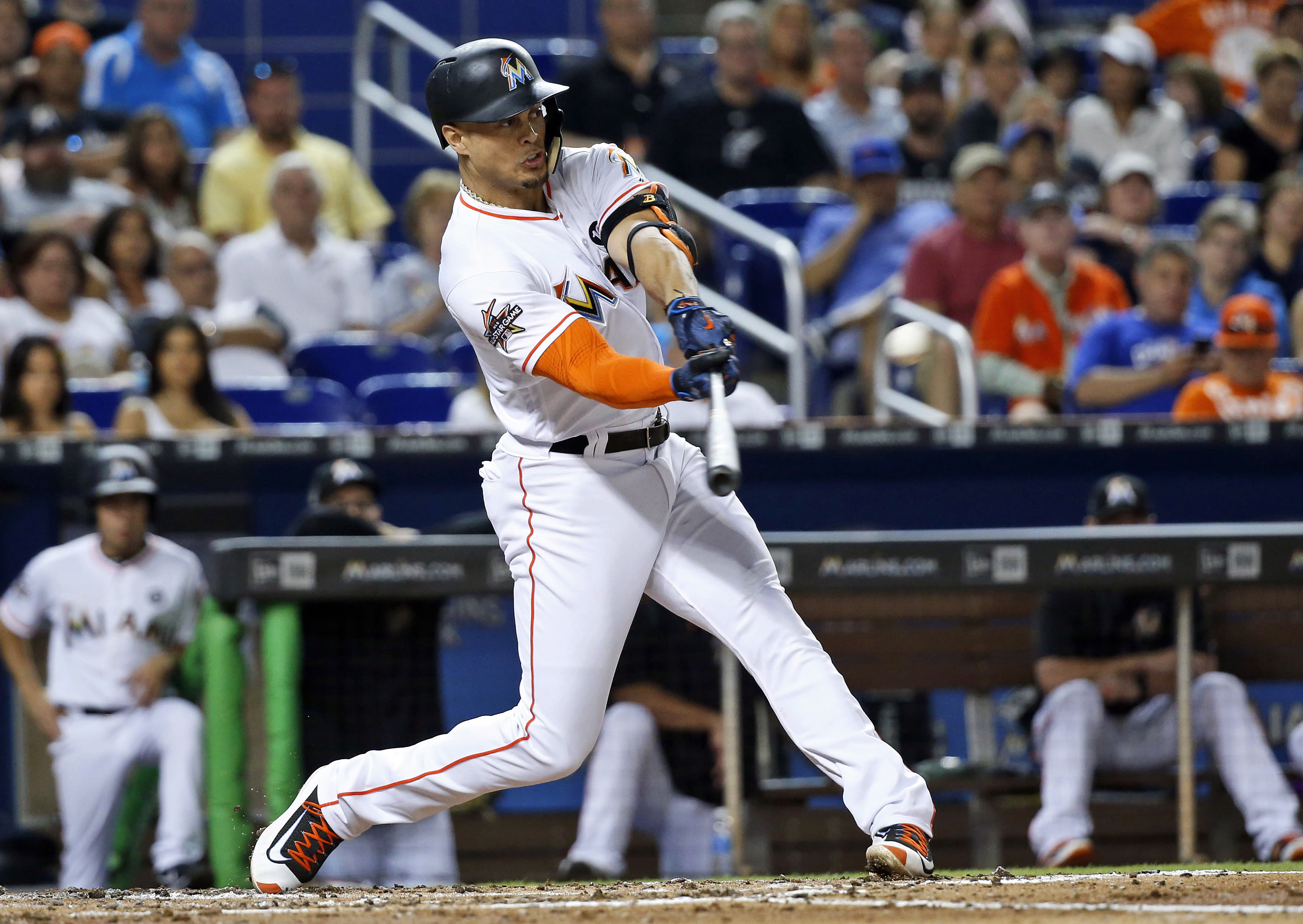 <p> FILE - In this June 23, 2017, file photo, Miami Marlins' Giancarlo Stanton hits a home run in the third inning of a baseball game against the Chicago Cubs in Miami. A person familiar with the negotiations says the New York Yankees and Miami Marlins are working on a trade that would send slugger Giancarlo Stanton to New York and infielder Starlin Castro to Miami. The person spoke to The Associated Press on condition of anonymity Saturday, Dec. 9, 2017, because no agreement has been completed. (AP Photo/Wilfredo Lee, File) </p>