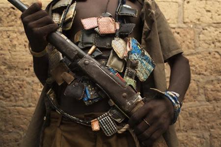 An anti-balaka militiaman poses for photograph on outskirts of capital Bangui