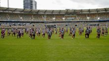 AFL's Lions take a knee in show of support