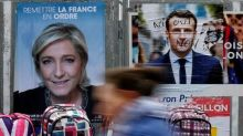 Hollande urges French to reject Le Pen in presidential runoff vote