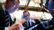 Wall Street termine dans le vert, moins inquiète sur le virus chinois