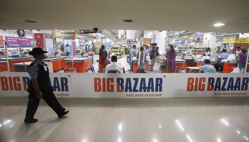A security personnel walks past the Big Bazaar retail store in Mumbai