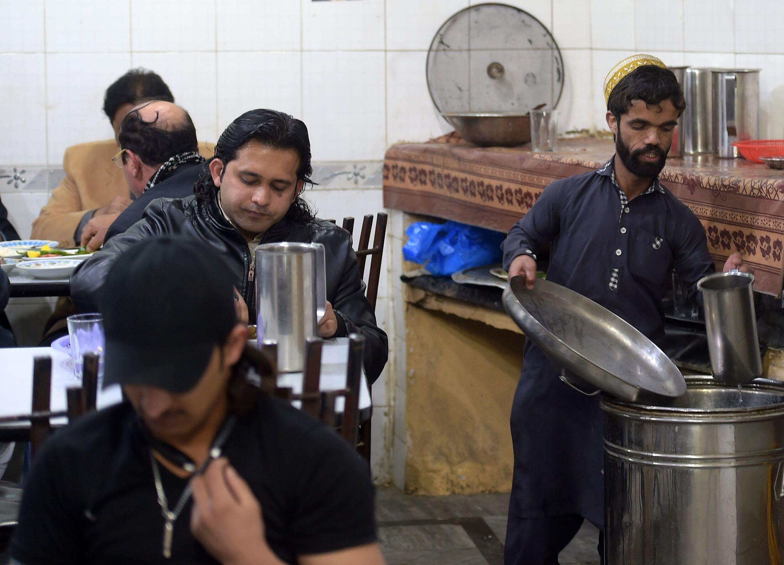 In this picture taken on February 22, 2019, Pakistani waiter Rozi Khan, 25, who resembles US actor Peter Dinklage, working at Dilbar Hotel in Rawalpindi. - Rozi Khan had never heard of the Game of Thrones -- or its hugely popular character Tyrion Lannister -- until his striking resemblance to the dwarf anti-hero got heads turning at home. (Photo by AAMIR QURESHI / AFP) / To go with PAKISTAN-LIFESTYLE-TELEVISION-ENTERTAINMENT        (Photo credit should read AAMIR QURESHI/AFP/Getty Images)