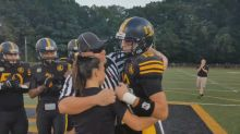 Army reservist poses as football referee to surprise his kids