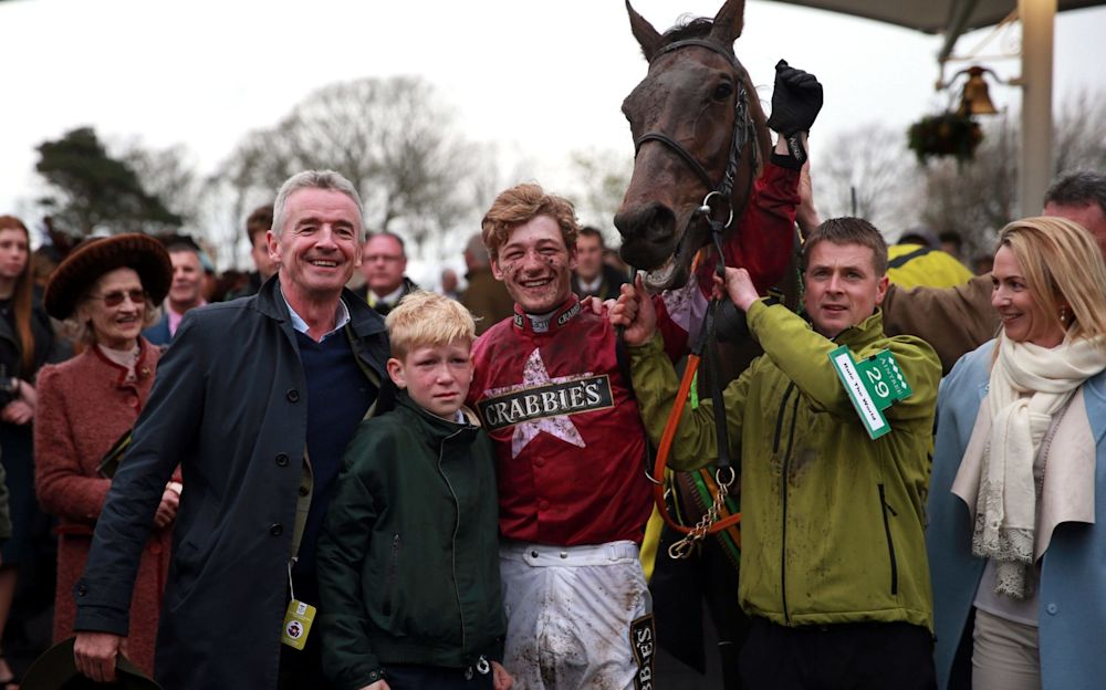 Owner Michael O'Leary (left) and jockey David Mullins celebrate with Rule The World after winning the 2016 Grand National - PA