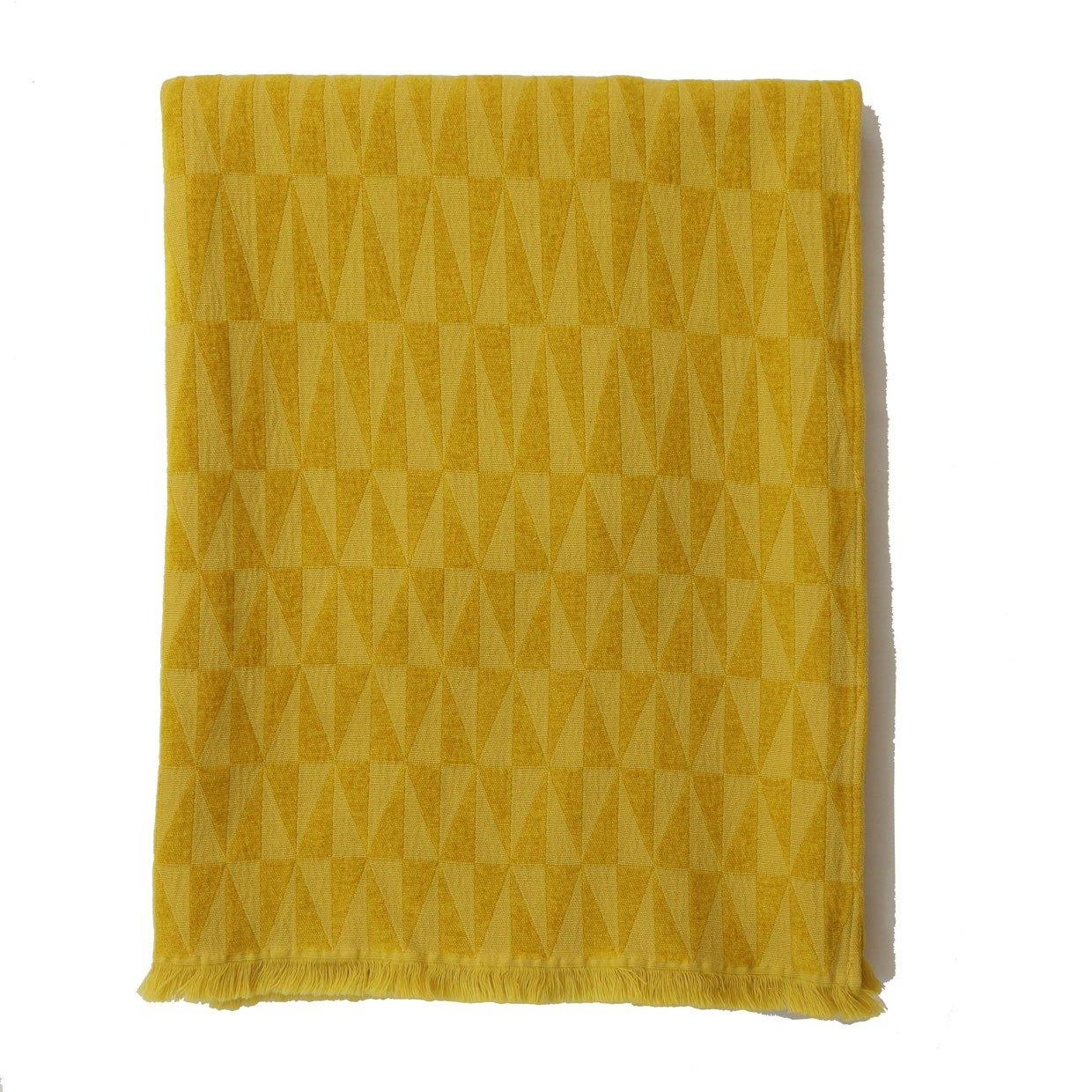 """Available in the pictured goldenrod—which is perhaps the most autumnal shade of them all—and five additional earth tones (all hand-dyed), this timeless knit throw from Johanna Howard is made of cotton and chenille for a luxe softness. $195, Johanna Howard Home. <a href=""""https://www.johannahoward.com/collections/throws/products/apex-throw"""" rel=""""nofollow noopener"""" target=""""_blank"""" data-ylk=""""slk:Get it now!"""" class=""""link rapid-noclick-resp"""">Get it now!</a>"""